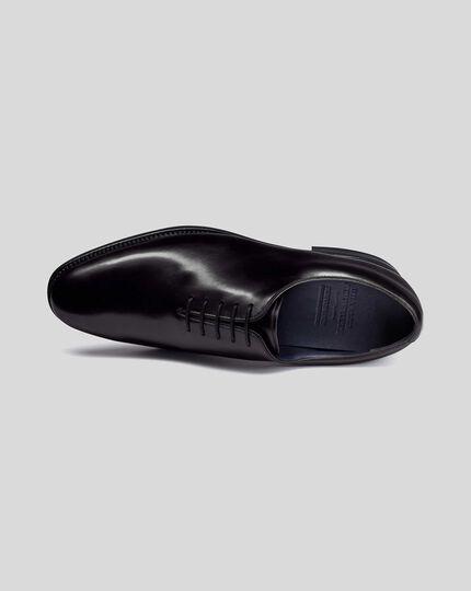 Rahmengenähte Performance-Schuhe mit Wholecut-Konstruktion in Schwarz